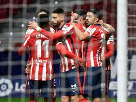 Atletico Madrid players celebrate one of their goals in a win over Valencia in La Liga. AFP