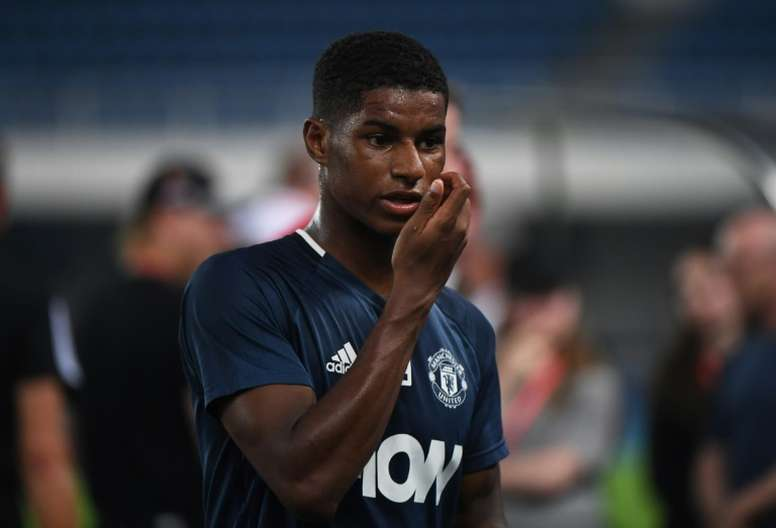 Manchester Uniteds Marcus Rashford walks off after a training session a day before the 2016 International Champions Cup football match between Manchester City and Manchester United, in Beijing on July 24, 2016