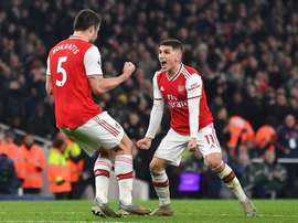 Sokratis (L) scored the second in Arsenal's victory over Man Utd. AFP
