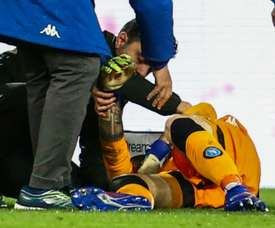 Medics tend to Ospina after head injury. AFP
