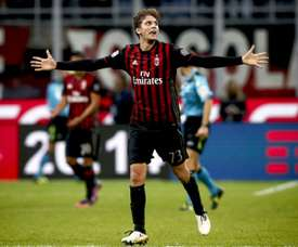 AC Milans midfielder Manuel Locatelli celebrates after scoring a goal during the Italian Serie A football match AC Milan versus Juventus on October 22, 2016