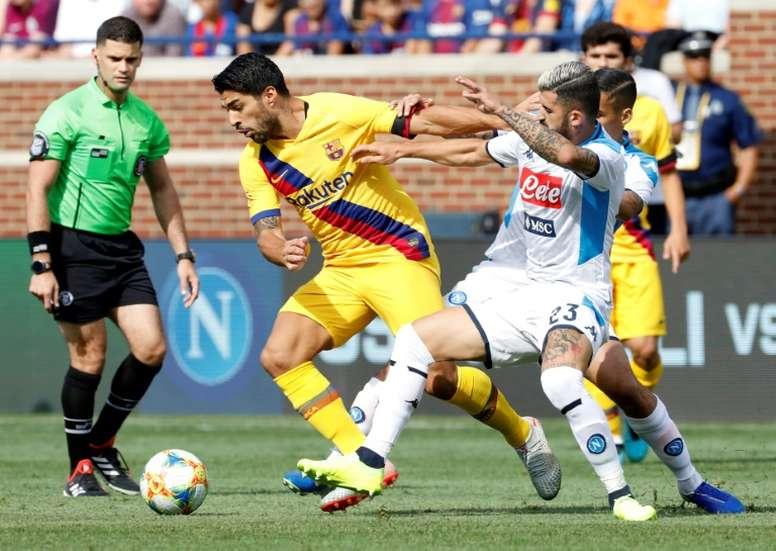 El presidente del Nápoles pide cambiar la sede del choque ante el Barça. AFP