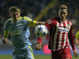 Astanas Kazakh defender Evgeni Postnikov (L) vies for the ball with Atletico Madrids forward Fernando Torres during the UEFA Champions League group C football match at the Astana Arena stadium in Astana on November 3, 2015