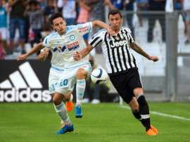 Marseilles Florian Thauvin (L) fights for the ball with Juventus Mario Mandzukic during the Robert Louis-Dreyfus Trophy friendly match, at the Velodrome stadium in Marseille, on August 1, 2015