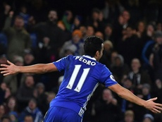 Chelseas midfielder Pedro celebrates scoring the teams third goal during the football match between Chelsea and Bournemouth at Stamford Bridge on December 26, 2016