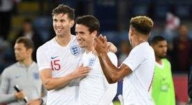 England's Ben Chilwell (centre) won his first international cap against Switzerland. AFP