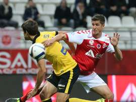 Reims French defender Anthony Weber (R) vies with Lilles Argentinian defender Renato Civelli during the French Ligue 1 football match on September 25, 2015 at the Auguste Delaune Stadium in Reims, northeastern France