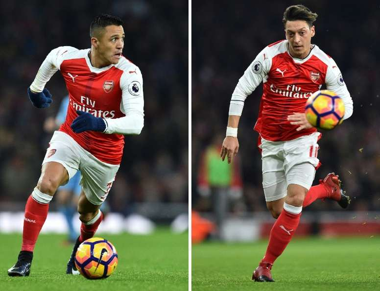 Wenger has given an update on the futures of Sanchez and Ozil. AFP