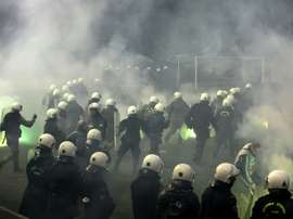 Riot police clashes with fans during a football match between Athens arch-rivals Olympiakos and Panathinaikos on February 22, 2015