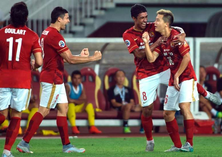 Guangzhou Evergrandes Huang Bowen (R) celebrates with teammates after scoring against Japans Kashiwa Reysol during their AFC Champions League quarterfinal match at the Tianhe Sport Center in Guangzhou on September 15, 2015