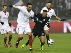 Lyon's Corentin Tolisso (C) vies with Sevilla midfielder Vicente Iborra (2ndL). AFP
