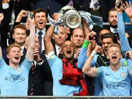 City lifted an unprecedented treble. AFP