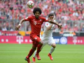 Bayern Munichs Brazilian defender Dante (left) and Mainzs midfielder Yunus Malli vie for the ball during their Bundesliga match at the Allianz Arena in Munich, southern Germany on May 23, 2015