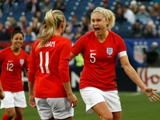 Steph Houghton (right) will be England captain in France. AFP