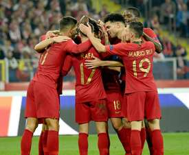 Portugal players celebrate victory in Poland. AFP