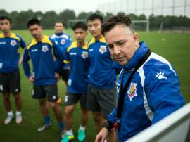 Gary White (R) has his eye on winning promotion to the Chinese Super League next season after saving Shanghai Shenxin from relegation