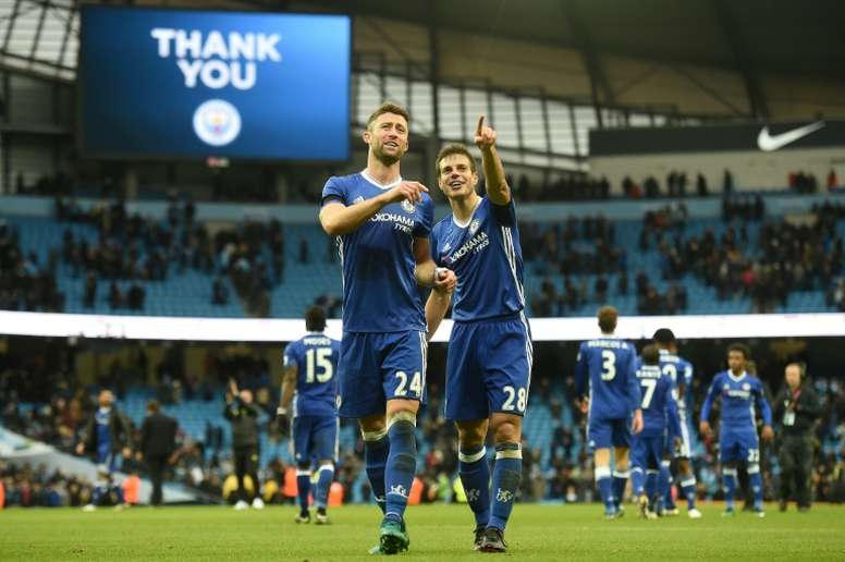 Chelsea's Cesar Azpilicueta (R) and Gary Cahill celebrate following their big win. AFP