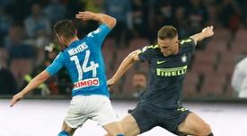 Skriniar (r) has confirmed he will stay at Inter Milan despite Real Madrid's interest. AFP