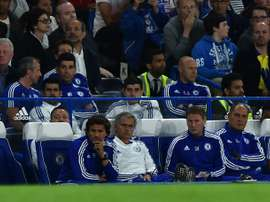 Manager Jose Mourinho (front row (2L) says Chelsea will have to survive a much sterner examination than last season if the champions are to mount a successful defence of the Premier League title