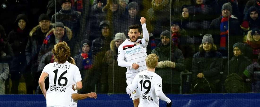 Leverkusen players celebrate opening the scoring. AFP