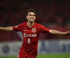 Former Chelsea man Oscar would play for China if FIFA changed the rules. AFP