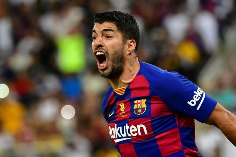 Luis Suarez will not be back until May at the earliest. AFP