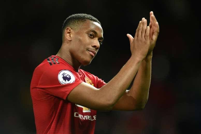 Martial says he is 'loving his time at the club' as he signs new deal. AFP