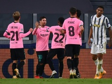 Lionel Messi helped Barca beat Juventus 0-2 in Turin. AFP