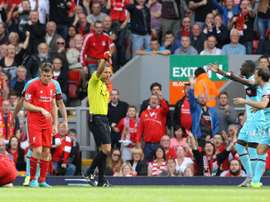 West Ham Uniteds Mark Noble (R) receives a red card from referee Kevin Friend (3rd R) for a challenge on Liverpools Danny Ings (Below L) during an English Premier League football match at Anfield in Liverpool on August 29, 2015