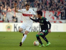 Stuttgarts Daniel Schwaab (L) vies with Hannovers Hiroshi Kiyotake during the German first division Bundesliga football match in Stuttgart, northern Germany, on February 27, 2016