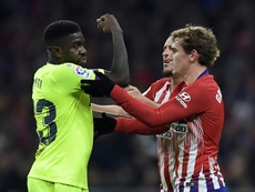 Umtiti and Griezmann pictured during a tussle. AFP