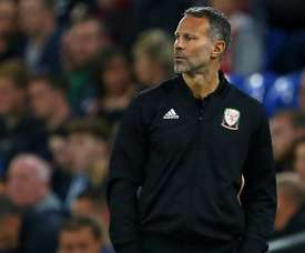 Giggs watches on as Wales fell to a 2-0 defeat to Denmark. AFP