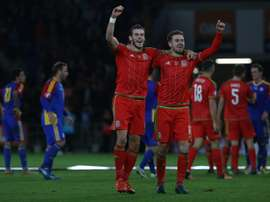 Waless midfielder Gareth Bale (L) and Waless midfielder Aaron Ramsey celebrate following Euro 2016 qualifying football match between Wales and Andorra at Cardiff City stadium in Cardiff, south Wales, on October 13, 2015
