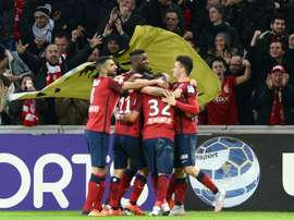 Lilles midfielder Eric Bautheac is congratulated by a teammates after scoring a goal during the French League Cup football match Lille versus Bordeaux at the Stade Pierre Mauroy stadium in Villeneuve-dAscq, France, on January 26, 2016