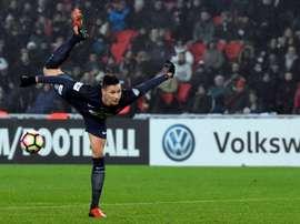 Paris Saint-Germains midfielder Julian Draxler shoots the ball during the French Cup football match between against Bastia January 7, 2017