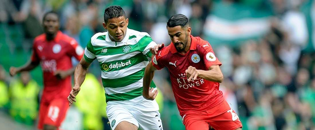 Celtics defender Emilio Izaguirre vies with Leicester Citys midfielder Riyad Mahrez (R) during the International Champions Cup match in Glasgow on July 23, 2016