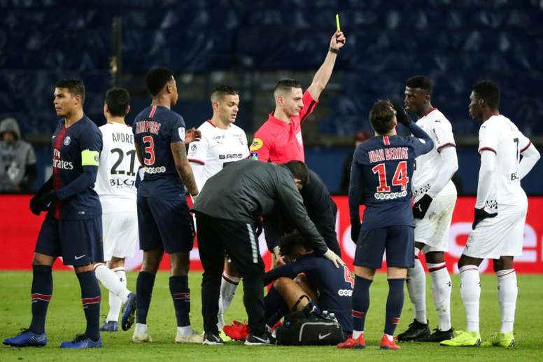Referee Karim Abed showed a yellow card to Rennes forward Mbaye Niang. AFP