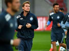 FC Bate's midfielder Aleksandr Hleb (2nd L) warms up during a training session on September 15, 2015