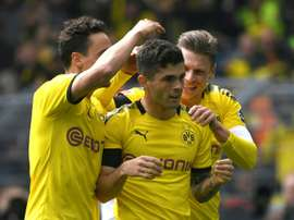 Dortmund took the title race to the wire after beating Duesseldorf. AFP