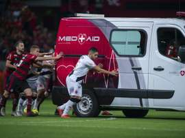 Players from both sides helped the vehicle off the pitch. AFP