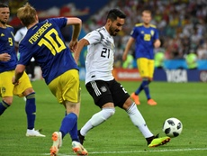 Gundogan says he wants to keep playing for Germany. AFP