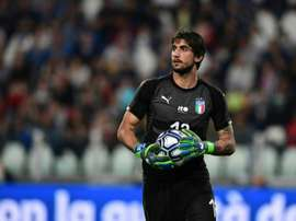 Juve goalkeeper Perin, Behrami return to Genoa. AFP