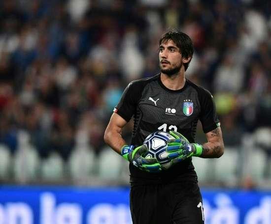 Juve goalkeeper Perin, Behrami return to Genoa. AFP
