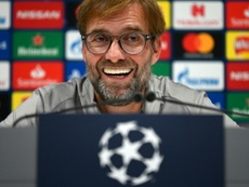 Klopp has defended him. AFP