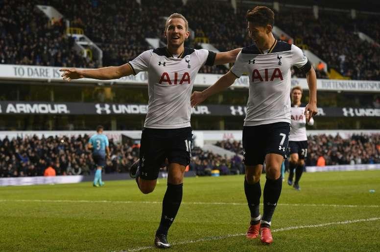 Kane (L) believes that Spurs can still win the Premier League. AFP