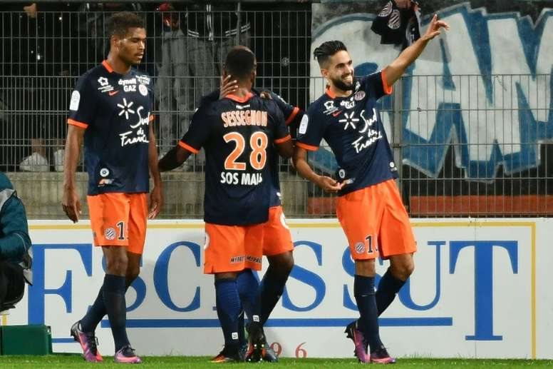 Ryad Boudebouz (R) celebrates scoring a goal against Marseille. AFP