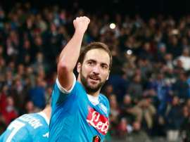 Napolis forward Gonzalo Higuain celebrates after scoring during an Italian Serie A football match against Inter Milan on November 30, 2015 at the San Paolo stadium in Naples