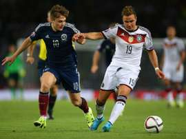 Germanys midfielder Mario Goetze (R) vies with Scotlands striker James Forrest during the Euro 2016 qualifying group D football match in Glasgow on September 7, 2015