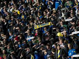 AFC Wimbledon fans cheer for their team at Stadium MK in Milton Keynes, central England, on December 2, 2012