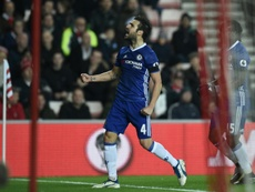 Chelseas Spanish midfielder Cesc Fabregas celebrates scoring his teams first goal during the English Premier League football match between Sunderland and Chelsea at the Stadium of Light in Sunderland, north-east England on December 14, 2016